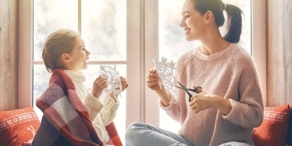 mother and daughter inside warm winter home